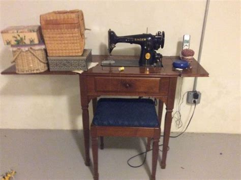 vintage singer sewing machine with cabinet and bench