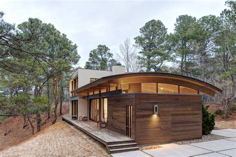 curved roof house designs contemporary forest house with curved metal roof modern house designs