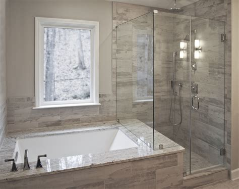drop in bathtub with shower bathroom remodel by craftworks contruction glass enclosed