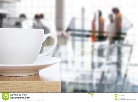 coffee cup on table in front of office stock photos
