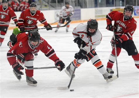 amid publicity tour denies affair with ridgefield holds new canaan in hockey battle