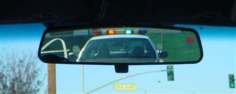 cop lights in mirror rear viewmirror