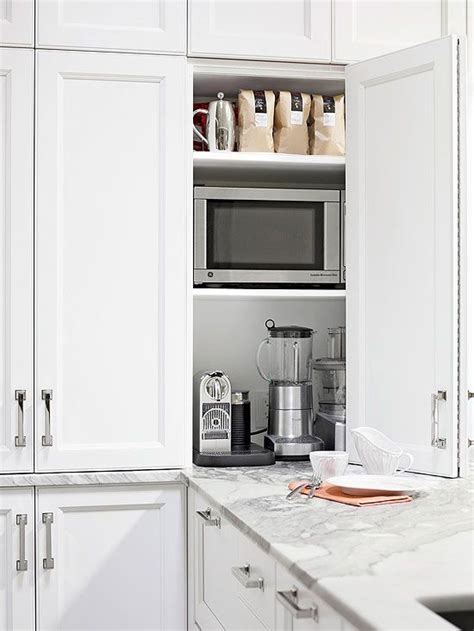 14 Strategies For Hiding The Microwave Appliance Garage Kitchen Appliance Storage Cabinets