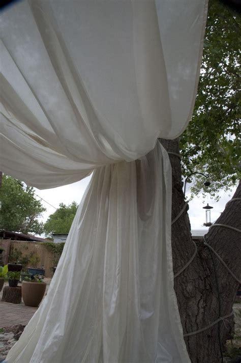 Homemade DIY wedding backdrop. Backyard wedding, fabric