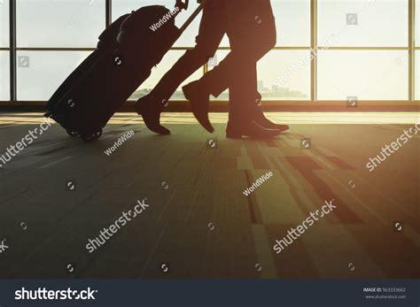 Happy Flight Checked Luggage Id Tracker Kartu Pengenal Tas Bandara silhouette traveler luggage walking airport stock photo 563333662