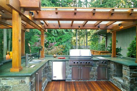 outdoor kitchen with stone cabinets and pergola design