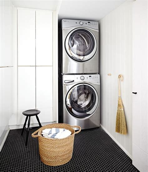 laundry room floor cabinets white and black laundry room with hex tiles transitional