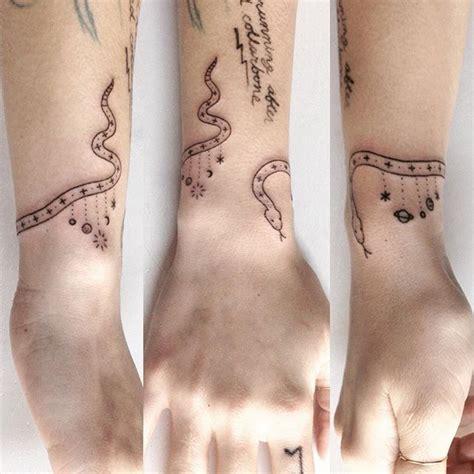 snake tattoo around wrist cosmic snake for effie 183 183 festivals