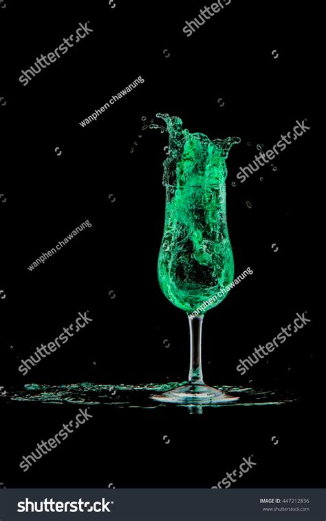 green cocktail black background drink cocktail green splash out glass stock photo