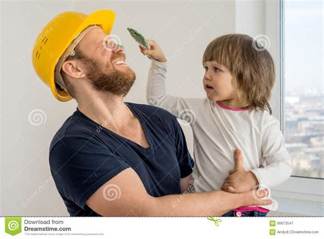 House Builder Tool happy family construction worker in helmet and small