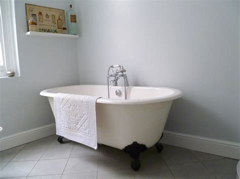 bathtub wall how to hang a display of vintage mirrors decorator s