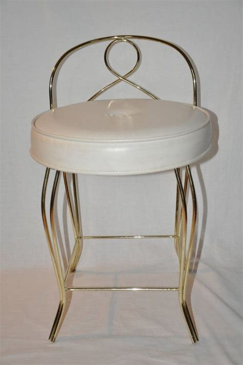 white and gold vanity chair 301 moved permanently