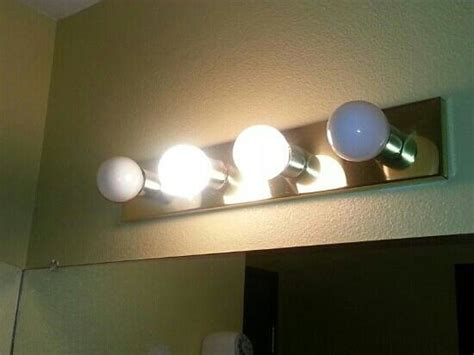 Bathroom Light Fixture I Guess They Figured It Didn T Changing Out Light Fixtures