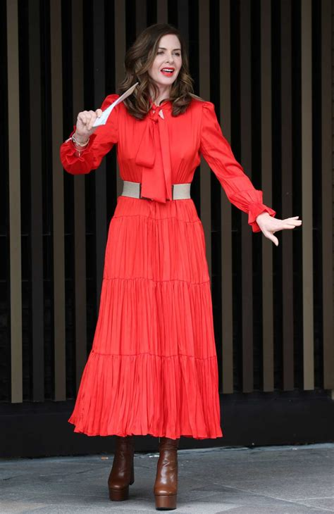 trinny woodall   red dress leaves itv studios  london celeb donut