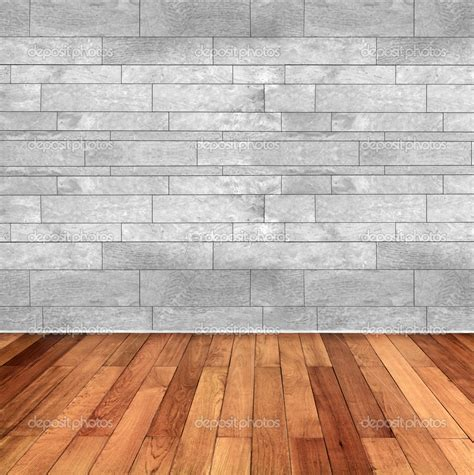 wooden floor empty room with wooden floor and white marble wall stock