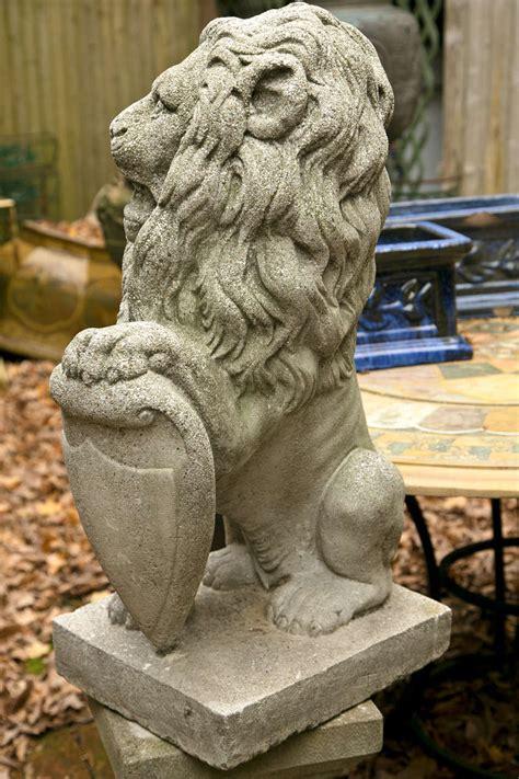 pair seated cast concrete lions  shields  sale