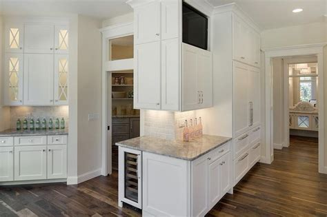 benjamin simply white cabinets angled kitchen with white granite countertops