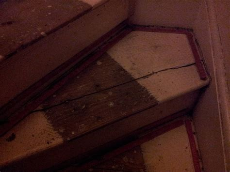 flooring replacing a split tread on an old staircase