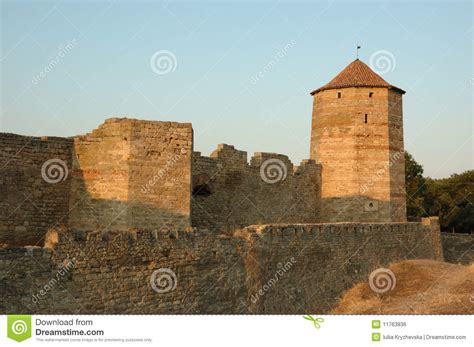 fortress bank moldavian fortress on the river bank at sunset royalty