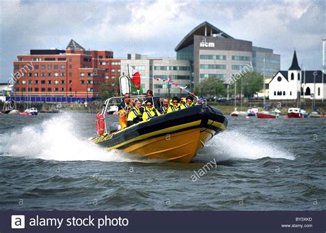 boat ride cardiff bay tourists enjoying a speedboat ride in cardiff bay stock