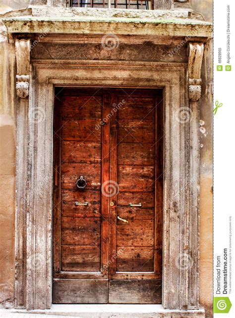 Tuscan Home Plans ancient wood door of a historic building in perugia