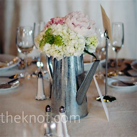 galvanized watering cans as centerpieces wedding ideas