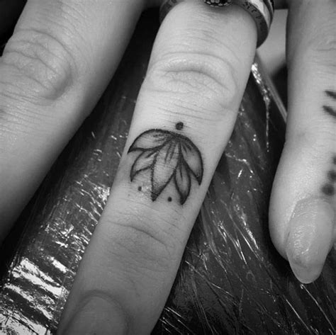 tattoo finger lotus 50 eye catching finger tattoos that women just can t say