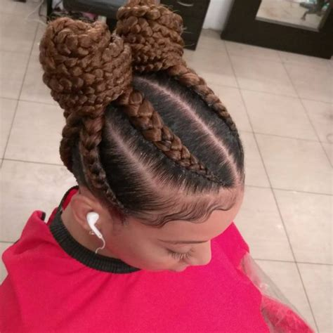 hairstyle with two corn row with bun to the side 31 ghana braids styles for trendy protective looks