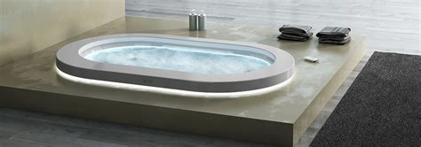 corian wood sunken whirlpool bath with wood marble or corian surround