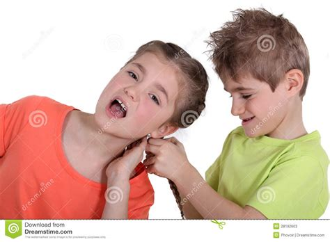 sister style brother hair brother pulling sister s hair stock photos image 28192603
