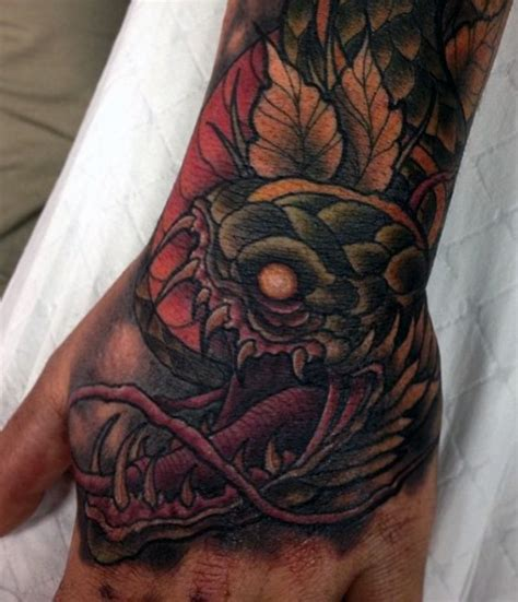 tattoo on hand snake 60 best snake tattoos collection