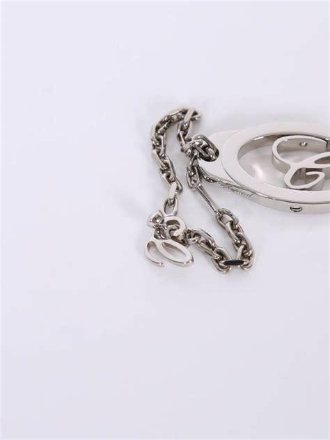 Chopard Silver chopard revolving c silver metal key chain luxury bags