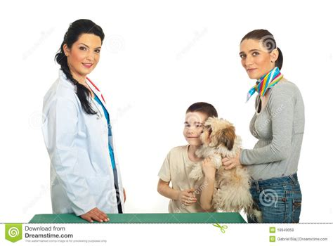 puppy vet visits family with puppy visit vet royalty free stock images image 18949059
