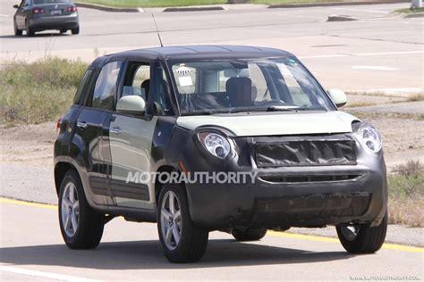tesla jeep tesla autonomous car jeep subcompact spied mixed