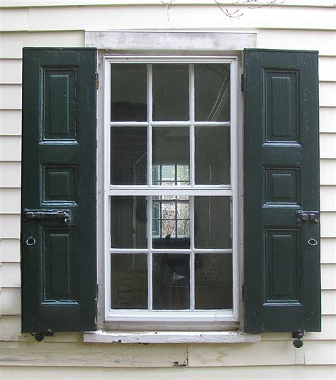 houses with shutters on windows protect your home with durable outdoor window shutters carehomedecor