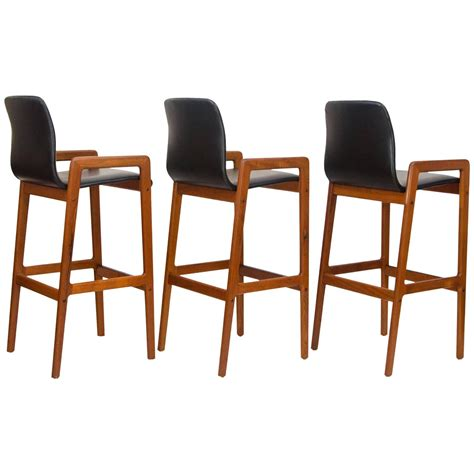 teak bar stools set of three danish teak bar or counter stools at 1stdibs
