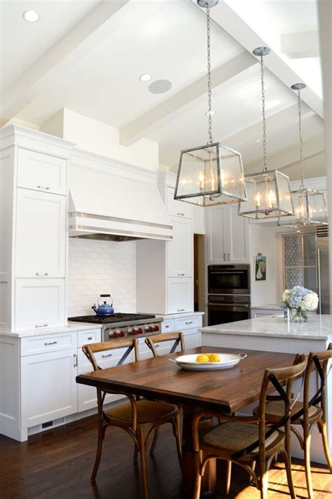 kitchen cabinets tall ceilings cabinetry integrated hood dining off island high