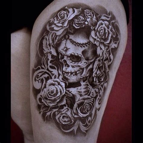 a black and grey day of the dead themed skull and roses
