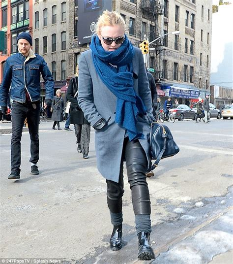 dakota fanning pairs a stylish coat and scarf as she tries to beat the frosty new york weather