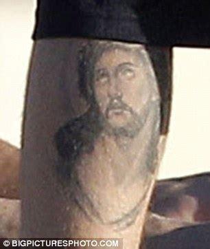 justin bieber leg tattoo justin bieber shows new jesus leg as he hits