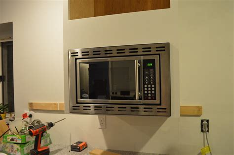 how to mount a microwave a cabinet customizing and hanging the microwave cabinet loving here