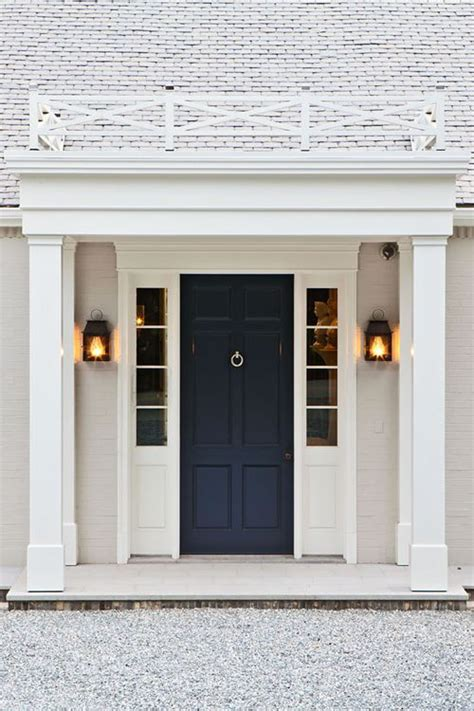 navy front door white brick navy door rail above architecture