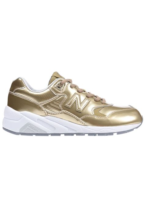 womens gold sneakers new balance gold new balance white off42 buy