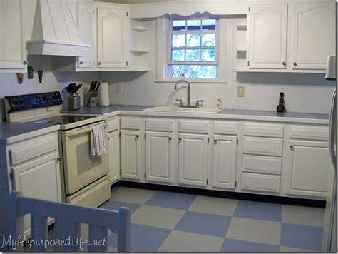 How To Paint My Kitchen Cabinets White by How I Painted My Vinyl Floor My Repurposed Life