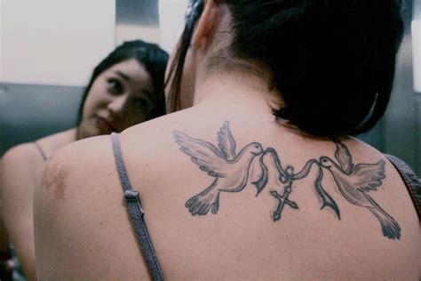 cross birds tattoo birds carying a cross http prettygirlytattoos