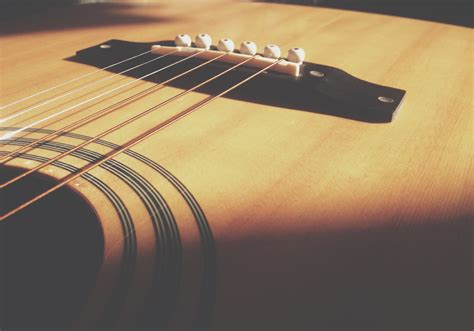 Acoustic Guitar Strings closeup photo of acoustic guitar and string 183 free
