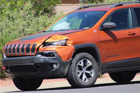 orange jeep cherokee failure to yield strikes again on bluff street 2 drivers