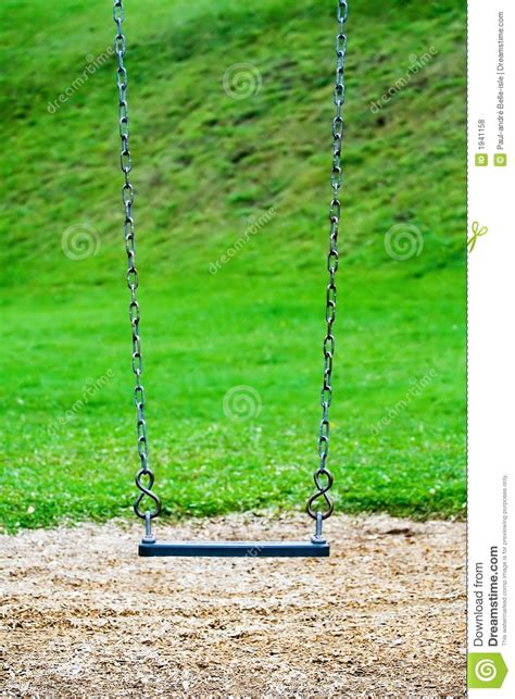 swing stock photos a swing in a playground royalty free stock photos image