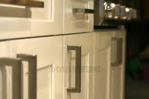 square bar pulls on white kitchen cabinets by celeste