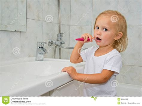 Shower In The Morning by Brushing Teeth In The Bathroom Stock Photo